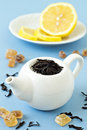 Free Small Tea Pot With Leaves Of Black Tea Royalty Free Stock Photography - 26569947