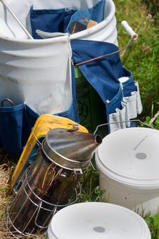 Free Beekeeping Equipment: Smoker & Pails Royalty Free Stock Image - 26560176