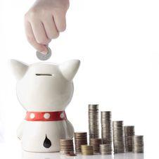 Free A Hand Saving Coin In Piggy Bank Royalty Free Stock Photos - 26567948