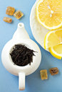Free Small Tea Pot With Leaves Of Black Tea Royalty Free Stock Photos - 26570058