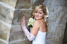 Free Happy Bride Near Stone Wall Stock Images - 26583814