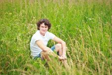 A Young Man Among Meadows. Stock Photo
