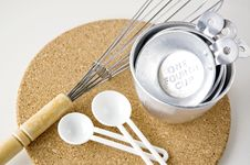 Measuring Cups With Spoon And Whisk Royalty Free Stock Photos