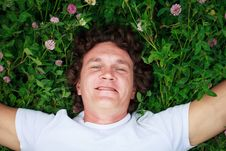 A Young Man Among Meadows. Royalty Free Stock Photography