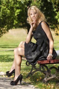 Blond Wonam In The Garden Stock Image