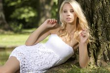 Blond Wonam In The Garden Royalty Free Stock Photography
