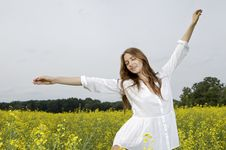 Free Brunette Woman In A Yellow Flowers Field Royalty Free Stock Photo - 26588935