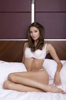 Free Beautiful Brunette In Bed Royalty Free Stock Photography - 26589057