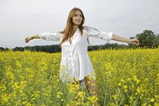Free Brunette Woman In A Yellow Flowers Field Royalty Free Stock Photos - 26589358
