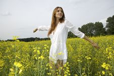 Free Brunette Woman In A Yellow Flowers Field Stock Images - 26589444