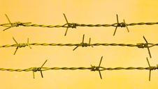 Free Barbed Wire Against A Grungy Old Wall Stock Photo - 26590860