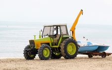 Tractor Raises Rowing Boat. Royalty Free Stock Photography