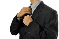 Free Adjusting Necktie Royalty Free Stock Photos - 26593838