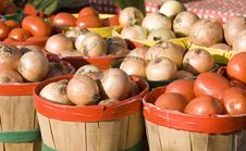 Baskets Of Onions And Tomatoes Royalty Free Stock Image