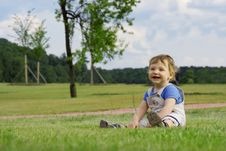 Free Boy On The Grass Royalty Free Stock Image - 2661646