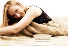 Free Blonde Girl Sitting On The Bed Stock Photos - 2663603