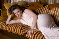 Free Beautiful Brunette On Couch Royalty Free Stock Photography - 2665437