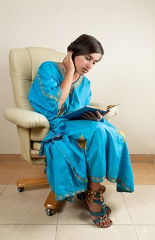 Free Girl Sitting In Chair Reading Book Stock Photos - 26619943