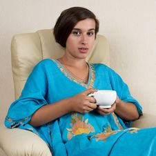 Free Girl Sitting In Chair With Cup Stock Photos - 26619973