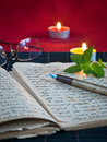 Free An Open Old Book By The Candlelight Royalty Free Stock Photography - 26621957