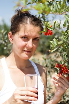 Free Adult Woman Drinking Pomegranate Juice Royalty Free Stock Photography - 26623077