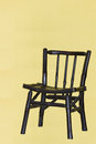 Free A Traditional Chair With Yellow Background And Sha Stock Image - 26635791