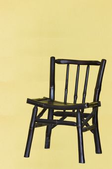 A Traditional Chair With Yellow Background And Sha Stock Image