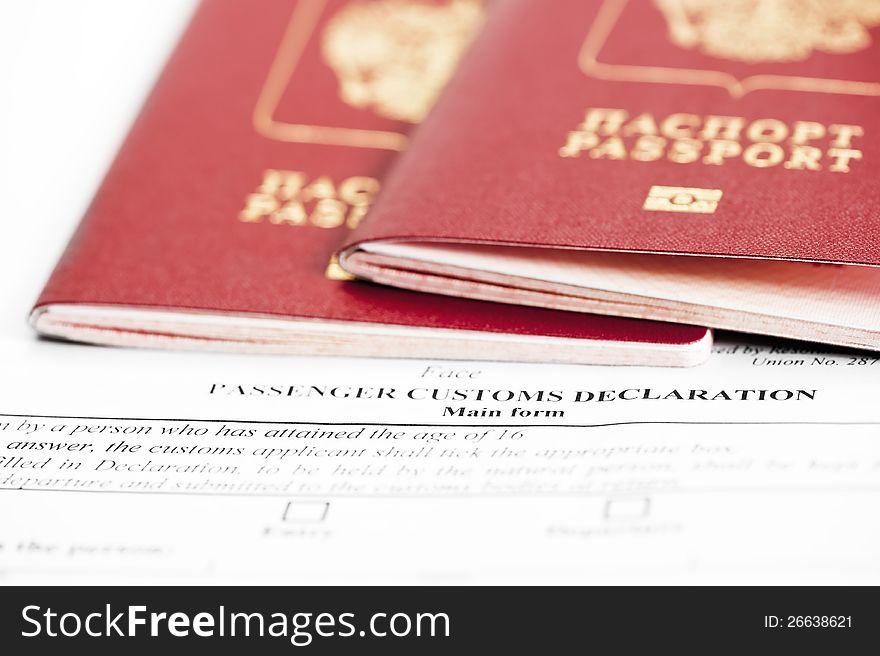 Two passports are on the passenger custom declarat