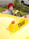 Free Woman Enters A Yellow Taxi Downtown Royalty Free Stock Images - 26642809