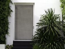 Free White Wall Entrance With Garden Stock Image - 26646091