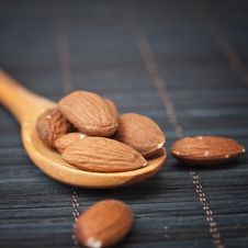 Free Almonds In A Wooden Spoon Stock Photo - 26653020