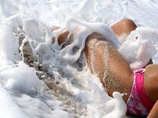 Free Legs Of Woman Lying In Surf Royalty Free Stock Photos - 26653908