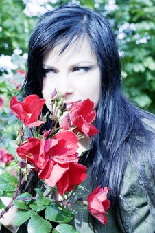 Beautiful Brunette Near Red Roses Stock Photo