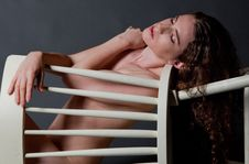 Nude Woman Behind Chair Royalty Free Stock Images