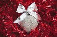 Silver Christmas Heart On Red Tinsel Stock Photography