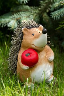 Clay Hedgehog With Red Apple Royalty Free Stock Image