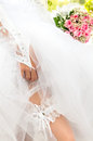 Free The Bride Shows The Garter On Her Leg Royalty Free Stock Photography - 26682737