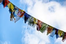 Free Buddhist Flags Against A Blue Sky Royalty Free Stock Image - 26687706
