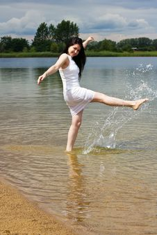 Free Happy Young Woman Splashing Water Stock Photo - 26692500