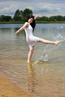 Happy Young Woman Splashing Water Stock Photo