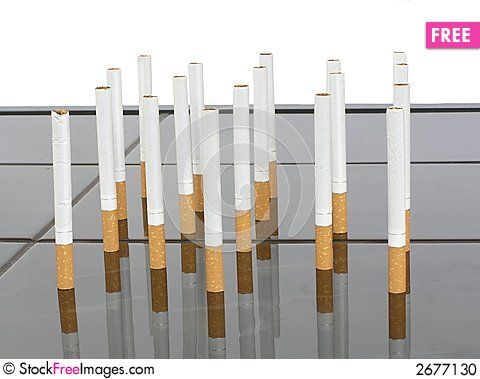 Free Cigarettes On A Table Stock Photo - 2677130