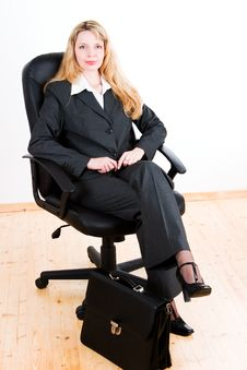 Free A Woman Sitting In A Chair Royalty Free Stock Photos - 2677308