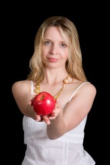 A Woman Holding An Apple Stock Image
