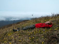 Free Girl Lying On The Mountain Top Stock Images - 2679474