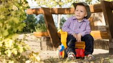 Free Young Boy Sitting In A Toy Dump Truck Stock Photos - 26718653