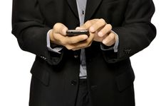 Free Man Using Cellphone Stock Photo - 26718660