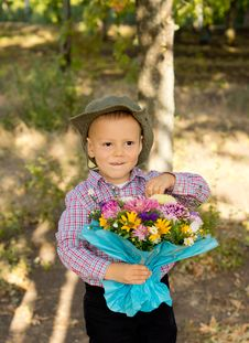 Free Mischievous Little Boy With Flowers Royalty Free Stock Image - 26718686