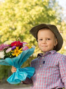 Free Happy Youngster With Bouquet Of Flowers Royalty Free Stock Image - 26718696