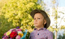 Free Concerned Little Boy With Flowers Royalty Free Stock Images - 26718699