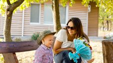 Free Little Boy Giving Mum A Bouquet Of Flowers Royalty Free Stock Image - 26718706